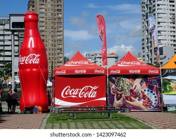 KAOHSIUNG, TAIWAN -- JUNE 7, 2019: A promotional tent and display for Coca-Cola beverages at the Dragon Boat Festival