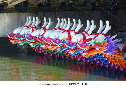 KAOHSIUNG, TAIWAN -- JUNE 7, 2019: Decorated dragon boats are anchored on the Love River in Kaohsiung in preparation for the Dragon Boat Festival