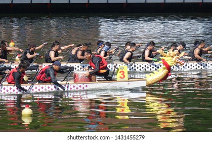KAOHSIUNG, TAIWAN -- JUNE 7, 2019: Teams compete in the yearly  Love River dragon boat races.