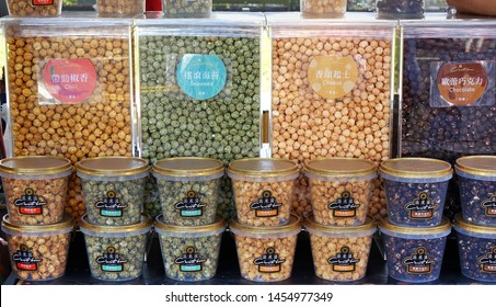 KAOHSIUNG, TAIWAN -- JUNE 7, 2019: A street vendor sells popcorn in a variety of flavors.