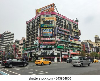 Kaohsiung, Taiwan - Mar 11, 2015. Traffic on street at downtown in Kaohsiung, Taiwan. Kaohsiung is, with over 2.7 million inhabitants, the second most populated city in Taiwan.