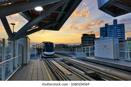 KAOHSIUNG, TAIWAN -- MARCH 2, 2018: A train of the new light rail system pulls into the Love Pier station at sunset time.