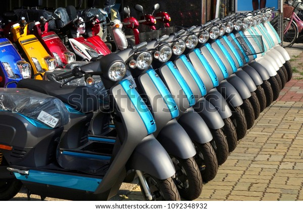KAOHSIUNG, TAIWAN -- MAY 12, 2018: To phase out gasoline scooters the switch to electric scooters is encouraged. Here is a line up of brand new electric scooters for sale.