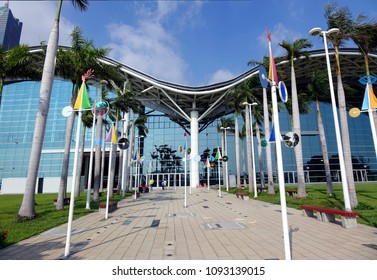 KAOHSIUNG, TAIWAN -- MAY 13, 2018: View of the eastern entrance of the Kaohsiung Exhibition Center decorated with modern designs and palm trees.