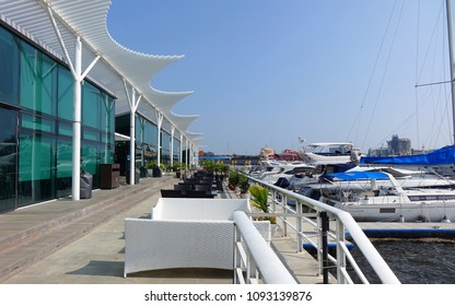 KAOHSIUNG, TAIWAN -- MAY 13, 2018: View of the Kaohsiung yacht harbor with its adjacent restaurant and coffee shop.