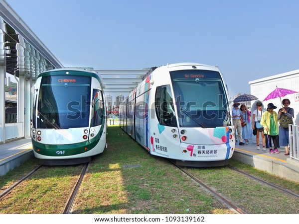 KAOHSIUNG, TAIWAN -- MAY 13, 2018: Passengers alight at the terminal stop of the recently completed Kaohsiung light rail system.