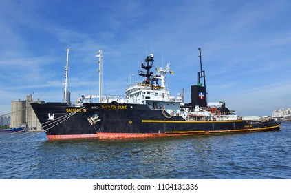KAOHSIUNG, TAIWAN -- MAY 26, 2018: Two large ocean-going tugs are anchored in the busy port of Kaohsiung, a major trading hub for Taiwan.