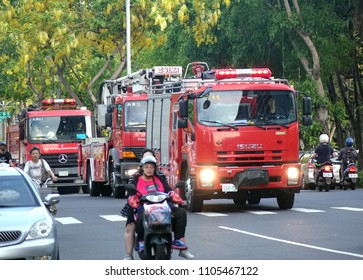KAOHSIUNG, TAIWAN -- MAY 26, 2018: Three fire truck are on an early evening rescue mission in the city of Kaohsiung.