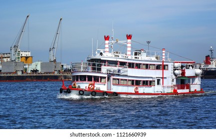 KAOHSIUNG, TAIWAN -- MAY 26, 2018: A tourism sightseeing boat passes through the Kaohsiung container port.