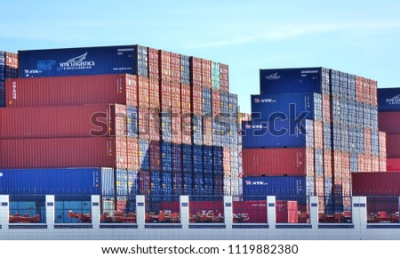 KAOHSIUNG, TAIWAN -- MAY 26, 2018: Large shipping container are stacked at the Kaohsiung container port in preparation for transport.