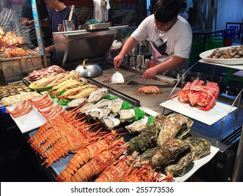 KAOHSIUNG, TAIWAN - NOV 27: Chief prepares seafood to be sold in Kaohsiung night market on November 27, 2014. People enjoy food at night market in Taiwan. And is one of the unique culture in Taiwan.