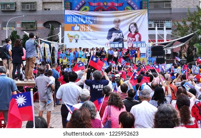 KAOHSIUNG, TAIWAN -- NOVEMBER 10, 2018: Supporters wave national flags at an election rally for KMT Kaohsiung mayor candidate Han Guo-Yun and city council member Huang Hsiang-Shu