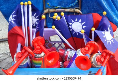 KAOHSIUNG, TAIWAN -- NOVEMBER 10, 2018: A vendor sells air horns and national flags at an election rally.