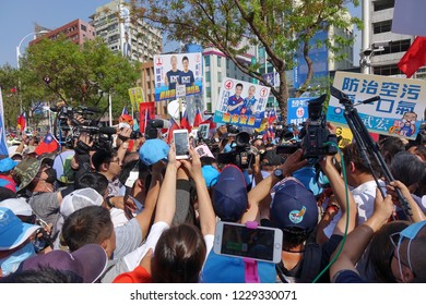 KAOHSIUNG, TAIWAN -- NOVEMBER 11, 2018: Supporters and media rush to greet KMT Kaohsiung mayor candidate Han Guo-Yun at an election event.