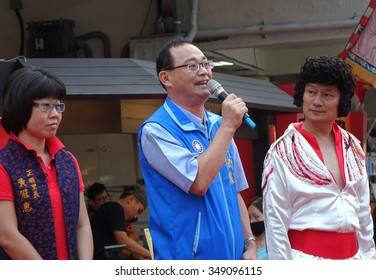 KAOHSIUNG, TAIWAN -- NOVEMBER 20, 2015: City counsellor and legislative candidate Huang Bo-Ling speaks at the opening ceremony of the Jianggong Outdoor Market.