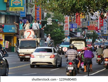 KAOHSIUNG, TAIWAN -- NOVEMBER 23, 2018: A motorcade in support in support of Kaohsiung mayor candidate Chen Chi-Mai from the DPP drives through dense traffic. Chen Chi-Mai lost the election.