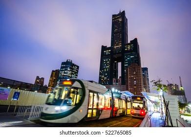 Kaohsiung, Taiwan - November 25 : View of light rail tram and the skyline in Kaohsiung, Taiwan on November 25, 2016. The light rail system in Kaohsiung is the first light rail transit in Taiwan.
