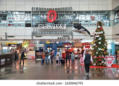 KAOHSIUNG, TAIWAN - NOVEMBER 30, 2018: Passengers enter Global Mall from Kaohsiung Main Station, Taiwan. Kaohsiung Station serves more than 14 million annual passengers.