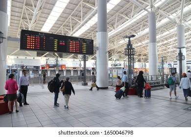 KAOHSIUNG, TAIWAN - NOVEMBER 30, 2018: Passengers visit Kaohsiung Main Station, Taiwan. Kaohsiung Station serves more than 14 million annual passengers.