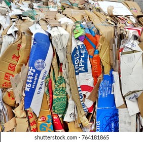 KAOHSIUNG, TAIWAN -- NOVEMBER 5, 2017: Paper, cardboard boxes and packaging has been compacted and tied up in preparation for recycling.
