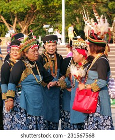 KAOHSIUNG, TAIWAN -- NOVEMBER 8, 2014: Taiwanese indigenous women are dressed in their traditional festive costumes