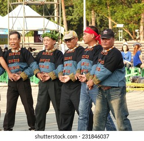 KAOHSIUNG, TAIWAN -- NOVEMBER 8, 2014: Male indigenous inhabitants of Taiwan perform a traditional wedding dance.