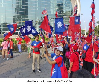 KAOHSIUNG, TAIWAN -- OCTOBER 10, 2019: An excited crowd waves national flags during the national day celebrations at a free, public event.