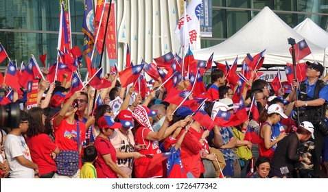KAOHSIUNG, TAIWAN -- OCTOBER 10, 2019: An excited crowd waves national flags during the national day celebrations at a free, public event. No credentials necessary.