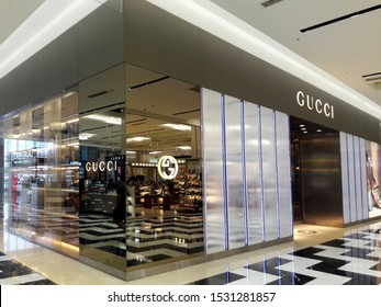 Kaohsiung, Taiwan, October 15, 2019: flared sign of Gucci. Gucci is an Italian fashion and leather goods brand founded by Guccio Gucci in Florence in 1921. Gucci has about 425 stores worldwide