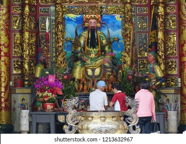 KAOHSIUNG, TAIWAN -- OCTOBER 19, 2018: People bring offerings and pray at the altar of the Yimin Temple.