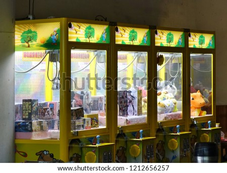 KAOHSIUNG, TAIWAN -- OCTOBER 19, 2018: Claw crane game machines have become the latest fad in Taiwan, occupying many empty store fronts.
