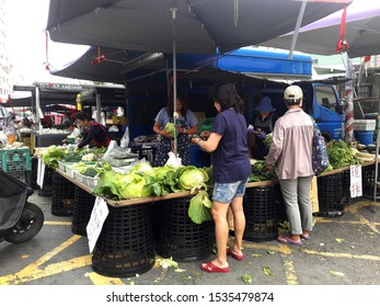 Kaohsiung, Taiwan, October 19, 2019: Taiwan's traditional local market is on the roadside, selling fresh vegetables and fruits, fresh meat and fish. The source of daily food for Taiwanese.