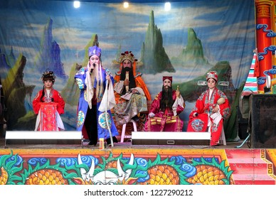 KAOHSIUNG, TAIWAN -- OCTOBER 26, 2018: Taiwan folk opera is performed in an outdoor public space as part of a temple celebration.
