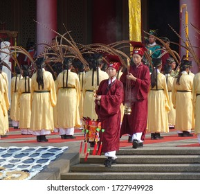 KAOHSIUNG, TAIWAN -- SEPTEMBER 28 , 2017: Ceremonial attendants in red robes take up positions for the yearly Confucius Ceremony held on Teachers Day.