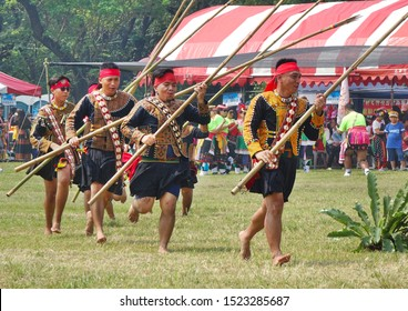 KAOHSIUNG, TAIWAN -- SEPTEMBER 28, 2019: Men with bamboo spears of the indigenous Rukai tribe perform a dance during the traditional harvest festival.