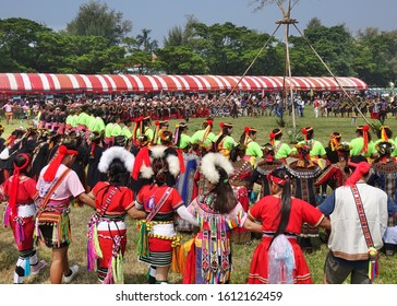 KAOHSIUNG, TAIWAN -- SEPTEMBER 28, 2019: Various indigenous tribes dance in a large circle during the traditional harvest festival.