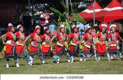 KAOHSIUNG, TAIWAN -- SEPTEMBER 29, 2018: Members of the indigenous Amis tribe in traditional costumes participate in the yearly harvest festival.
