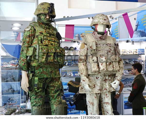 KAOHSIUNG, TAIWAN -- SEPTEMBER 29, 2018: A trader sells military fatigues at Kaohsiung International Maritime & Defence Expo
