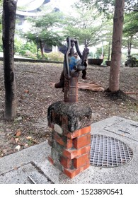Kaohsiung, Taiwan, September 29, 2019: Taiwan old pumped groundwater pump, manual water pump