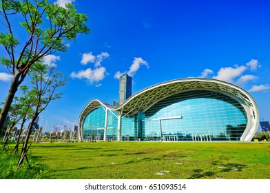 Kaohsiung, Taiwan - September 5, 2015: View of the Kaohsiung Exhibition Center and the 85 story Tuntex Tower in a sunny day on September 5, 2015 in Kaohsiung, Taiwan.
