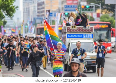 Kaohsiung, Taiwan-November 25, 2018: Chi Chia Wei, First Gay Right (Sam Sex Marriage) Protector of Taiwan, With His Rainbow Suits and Flag in Front Of The Marching Parade Of LGBT Pride Kaohsiung