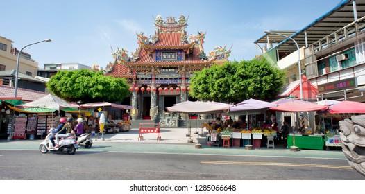 Kaohsiung,Taiwan - Dec. 9, 2018 - Buddest Temple on busy street in Kaohsing, Taiwan.