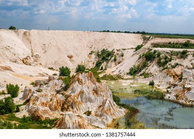 Kaolin career with white plaster material and lake, Vetovo village area, Bulgaria