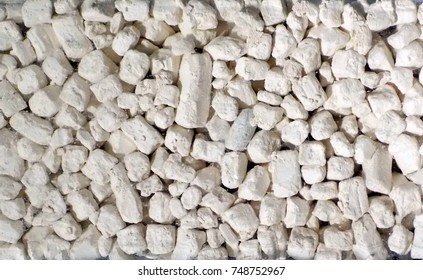 Kaolin or china clay. The main uses are in the production of paper, ceramics, toothpastes and cosmetics