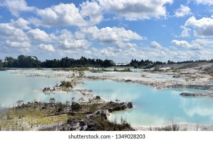 Kaolin Lake in Belitung Island, the water's vibrant light blue contrasting the white sandstone makes for an astonishing view, Indonesia