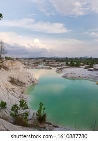 Kaolin Lake is a lake that has a clean white land color and bright blue and green water, that is formed from a former Kaolin mining site that has been abandoned and nature perfects with its beauty.