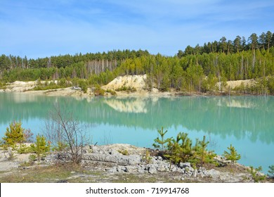 Kaolin quarry, blue lake in Kyshtym, Russia. Beautiful summer landscapes.