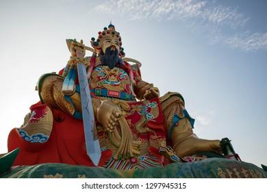 Kaoshiung, Taiwain - January 12, 2019: God of the North Pole sits atop taoist pagoda at Pei Chi Pavilion on Lotus Pond