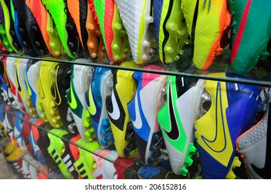 KAP CHOENG,SURIN,THAILAND-APRIL 24: Rows of colorful sport shoes at the  Chong Jom market near Thailand-cambodia border on April 24,2014 in Kap Choeng, Surin,Thailand.Products are imported from China.