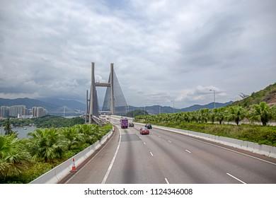 Kap Shui Mun bridge between Ma Wan island and Lantau island in Hong Kong, China by road view with sky background and copy space